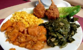 Fish or chicken with candied yams greens and buttered corn 13 95