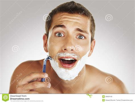 shaving in the bathtub young man shaving in the bath stock photo image 26603140