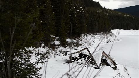 Frozen Cabin by Abandoned Lake Cabin Near Frozen Lake With Pan Stock Footage 3768575