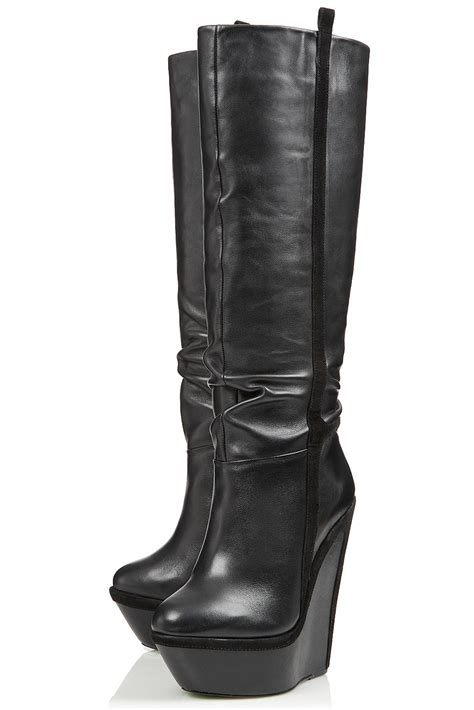wedge boots lyst topshop winters wedge boots by cjg in black