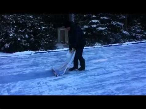 how to flood a backyard rink how to flood a backyard rink without a water hose youtube