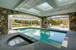 indoor and outdoor pool indoor outdoor pools exterior traditional with backyard levels night patio beeyoutifullife com