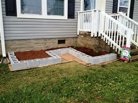 exterior development with flower bed ideas front of house