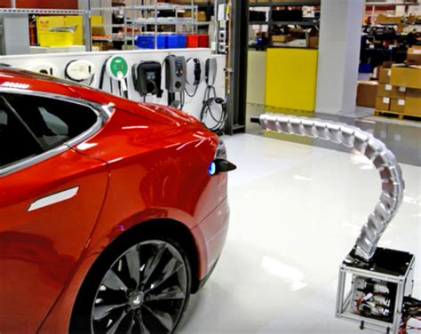 How Does A Tesla Charge Last Tesla Unveils A Snake Like Robotic Charger That Can