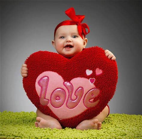 baby holding a plush for valentines day by