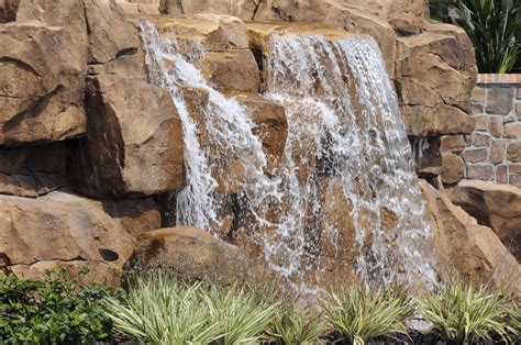 how to build a waterfall into a pool we build a natural looking swimming pool rock water