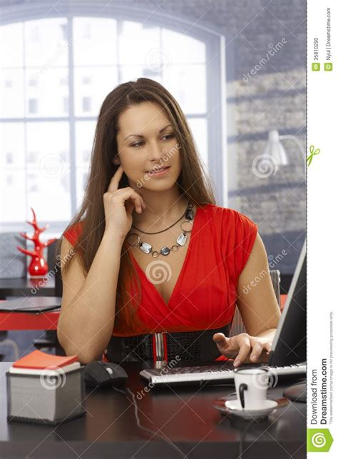 pretty working at desk stock photo image 35810290