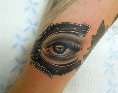 eye tattoo for horses shoe horse and eye good luck charm arm tattoo by phatt