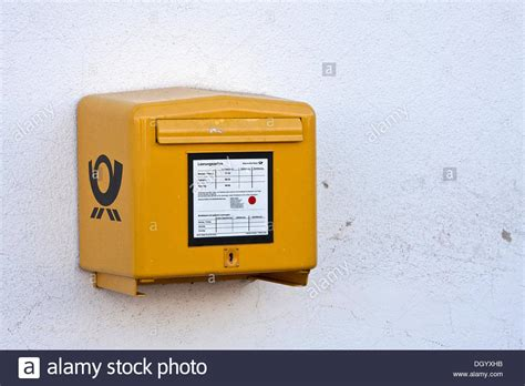 yellow post box german post stockfotos yellow post box