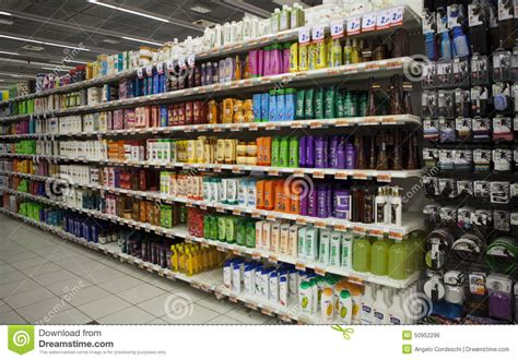 Shelf Of Product by Shelving With Hair Products And Store Editorial