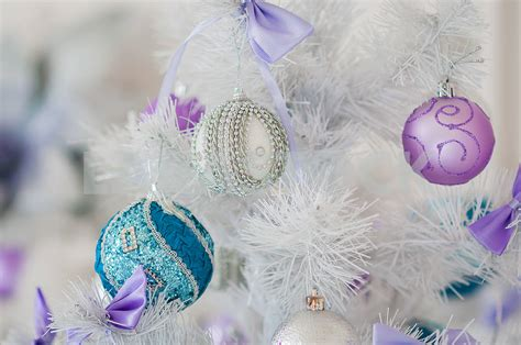 silver and blue tree decorations closeup of tree decorations silver