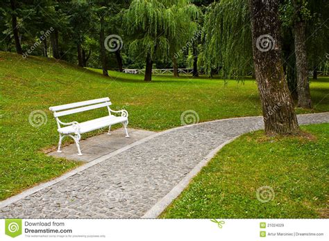 white park bench white park bench royalty free stock images image 21024029