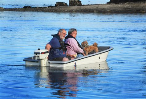 motor boat dog couple with dog on small boat stock image image of