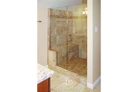 Brass Shower Doors This Glass Shower Door Has Inline Shower Frameless Shower Doors Brass Finish Low Iron Glass