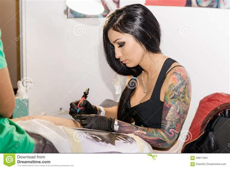 xs tattoo prices minsk belarus september 19 2015 professional woman