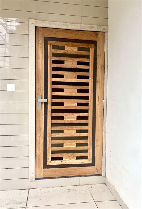 wooden door design image  nishi shah   home door
