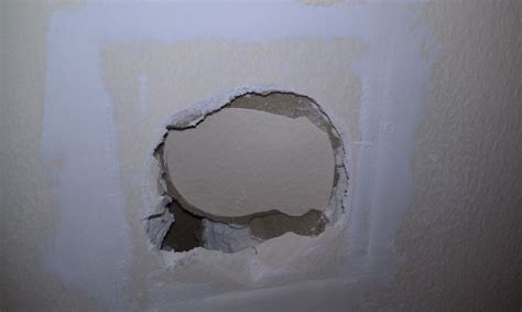 fix hole in wall how to fix a hole in the wall