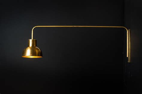 brass swing arm wall l brass swing arm wall light felix lighting specialists