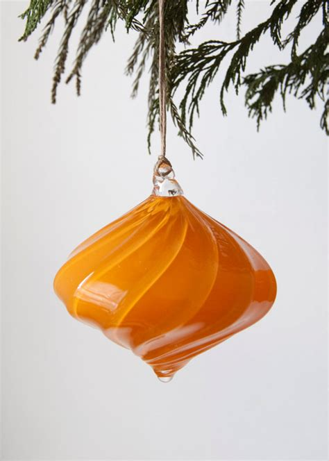 bright orange holiday ornament in onion by workingmanhandmade