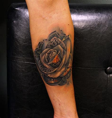 amazing metal rose tattoo by andres acosta best tattoo