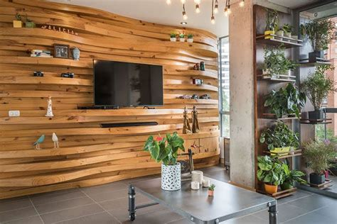 wavy wood accent wall creates multiple shelves