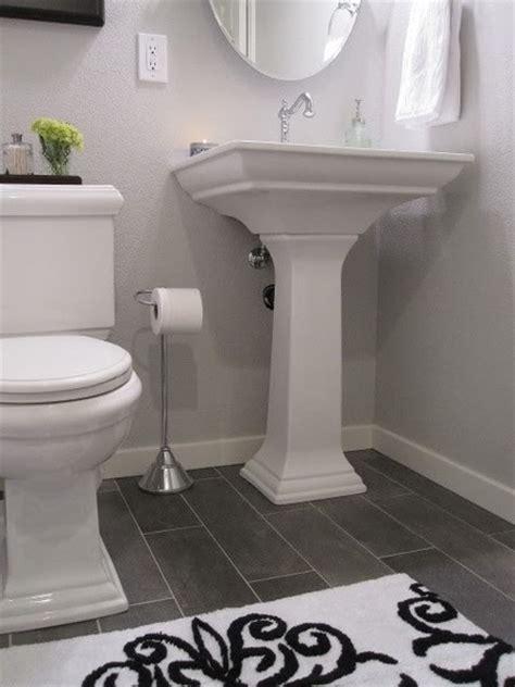 White bath dark floor