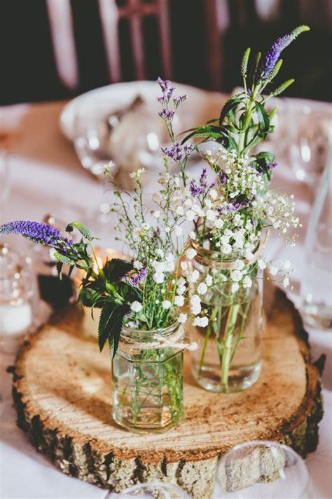 rustic log centerpieces 17 best ideas about wedding log centerpieces on