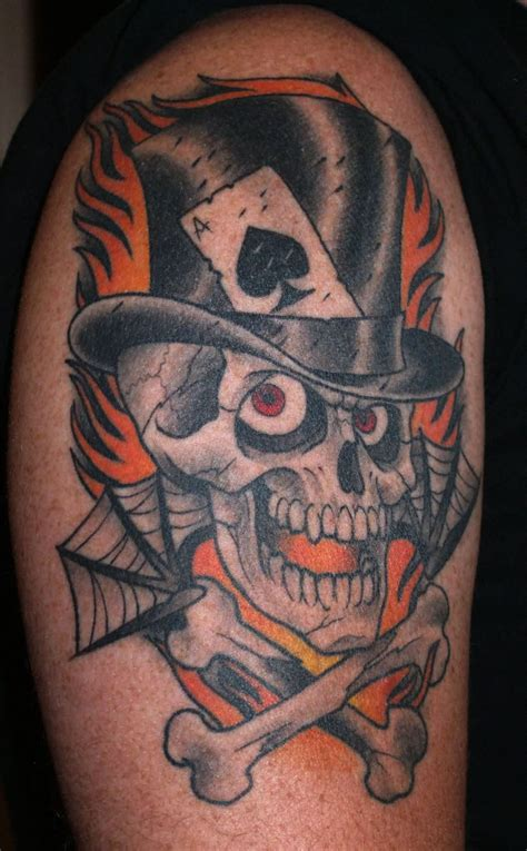 cross bones tattoo flames top hat skull and cross bones tattoos in 2017 real