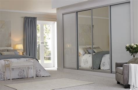White Glass Sliding Wardrobes by Sliding Wardrobes Glass Mirrored Fitted Wardrobes From