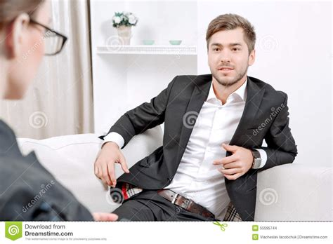 the couch doctor young man with his psychologist stock photo image 55595744