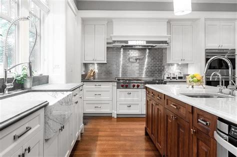 White Kitchen Cabinets with Stainless Steel Subway Tile