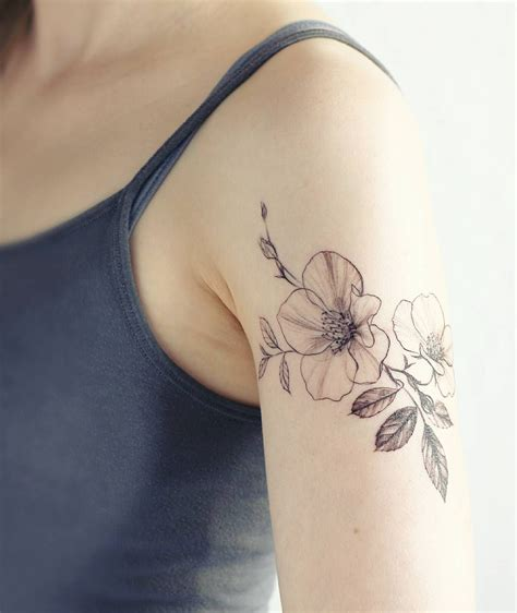 wild rose tattoo delicate by tattooist flower verena