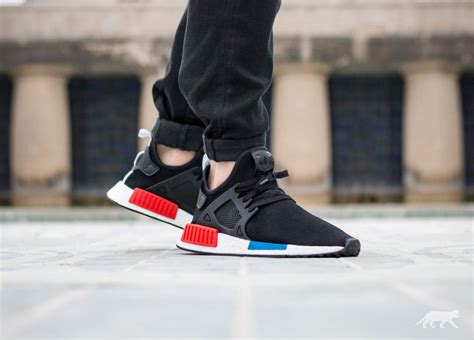 Sepatu Adidas Nmd Xr1 Og Black Blue Premium High Quality on foot look at the adidas nmd xr1 quot og quot sneakernews