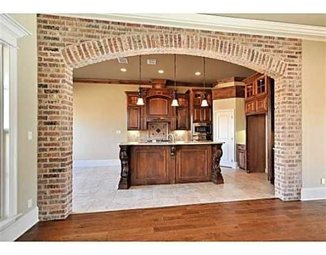 future house kitchen love the red on walls and ceiling brick arched opening kitchen pinterest the two