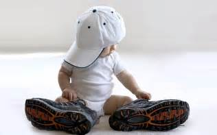 shoes for with big baby with big shoes and baseball cap