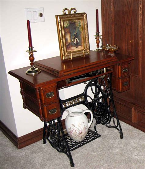 antique singer sewing machine in cabinet 301 moved permanently