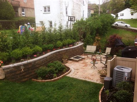 how to level a sloped backyard multi level yard patio below retaining wall