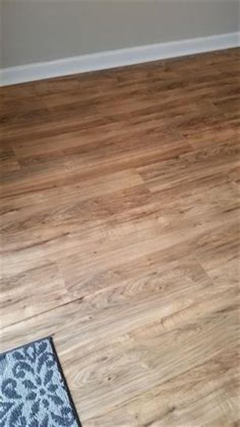 care of trafficmaster laminate flooring trafficmaster lakeshore pecan 7 mm thick x 7 2 3 in wide