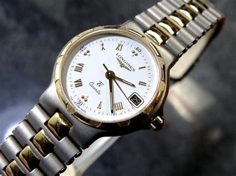 s longines conquest titanium quartz 18k gold bezel