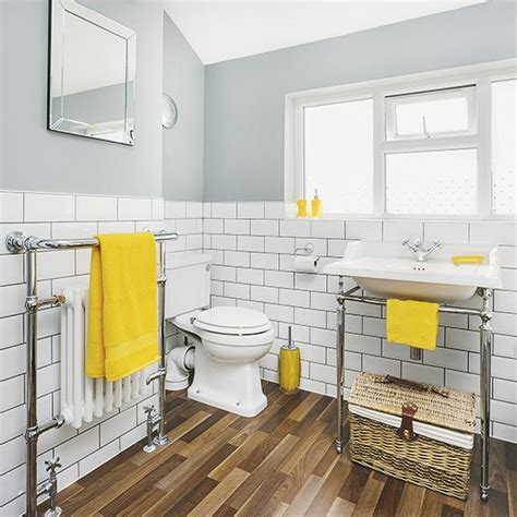 White and grey bathroom with yellow accents and faux wood flooring housetohome co uk