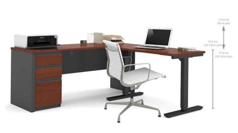 electric desks that adjust height l desk with electric height adjustable table by bestar