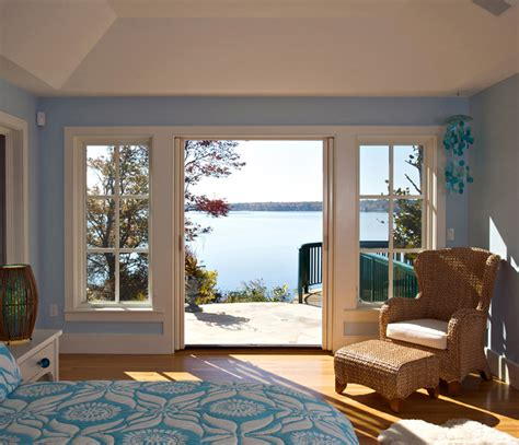 lake house windows beautiful wicker ottoman in living room beach style with beadboard walls next to white