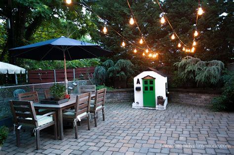 string lights in backyard outdoor string lights hung limestone