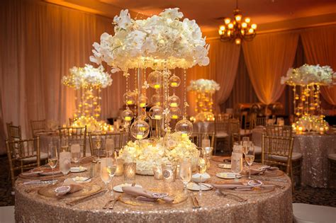 ivory wedding centerpieces ivory and gold collina wedding a chair affair inc