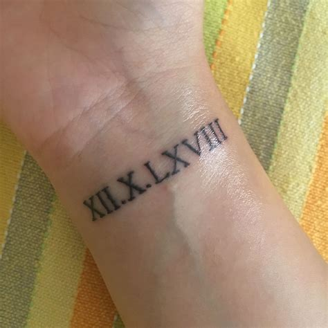 greek wrist tattoos numeral wrist ideas