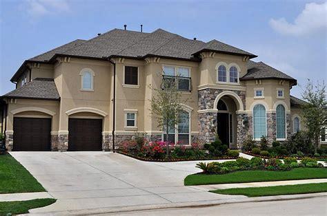 stucco home designs stucco colors dark stucco and stone houses stucco colors