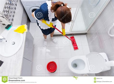 Cleaning Bathroom Floor by Housekeeper In A Hotel Mopping A Floor Stock Image Image