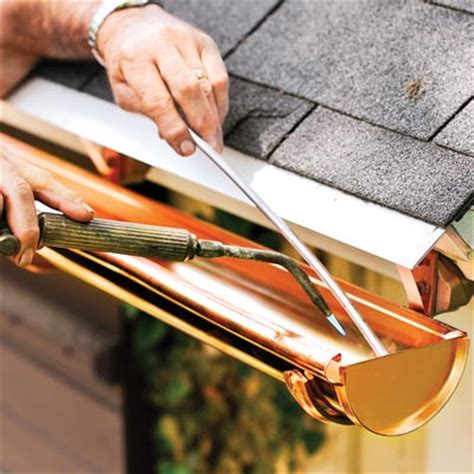 how to install gutters 12 steps ehow solder the seams how to install a half round gutter