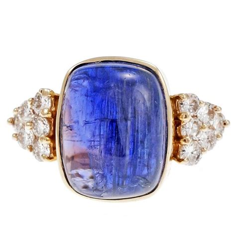 blue purple tanzanite gold engagement ring for
