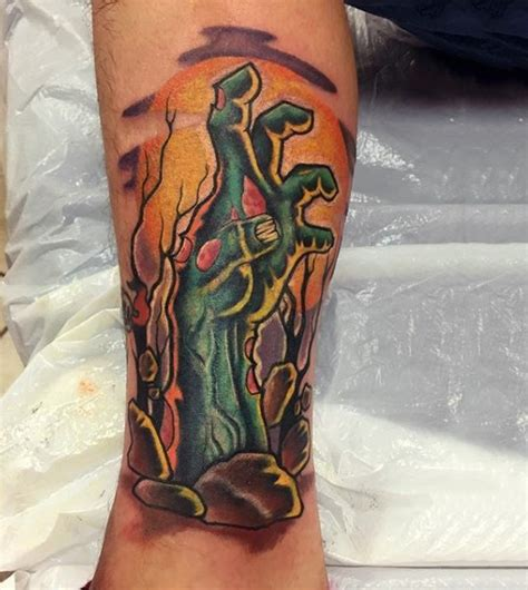 zombie tattoo on the hand tattooimages biz cartoon style colored arm tattoo of zombie hand